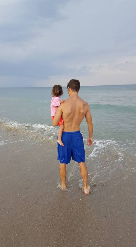 Standing with Avery in Ocean_Back