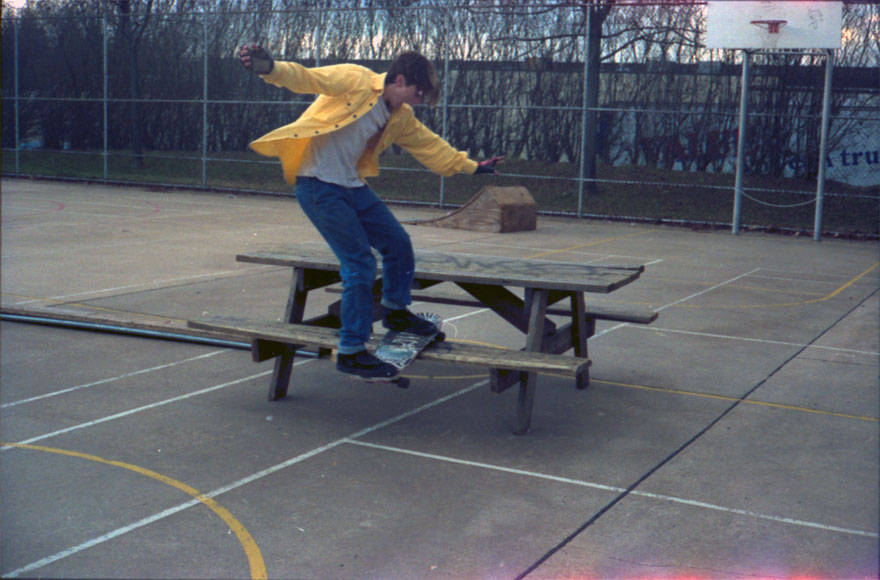 Me boardsliding a picnic table at the old Lutherville.