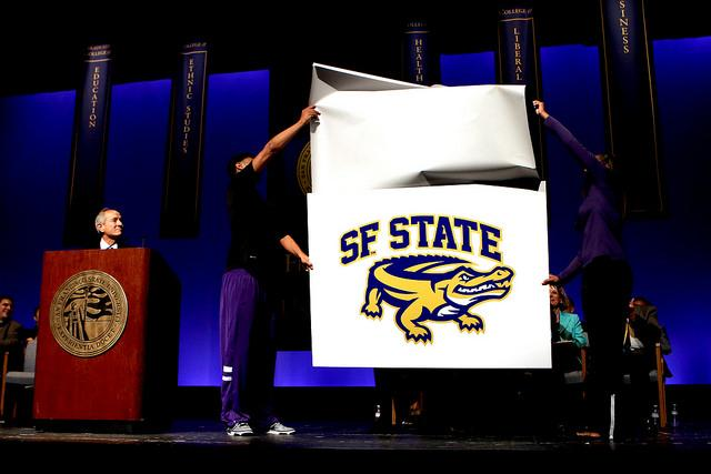 "Udun Osakue and Jazmine Williams present the ""new"" SF State Gator mascot image at the Opening Faculty Meeting (2014-2015) at the McKenna Theatre Monday, August 25 at SF State."