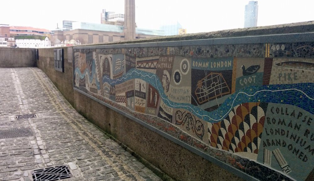Queenhithe Mosaic on the north bank of the Thames. Tate Modern is visible across the water.