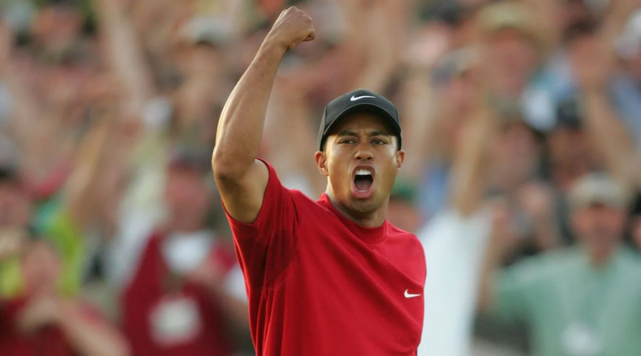 when did tiger win his first masters