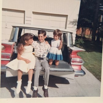 3 kids on station wagon