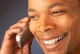 Smiling_man_talking_on_cell_phone_1