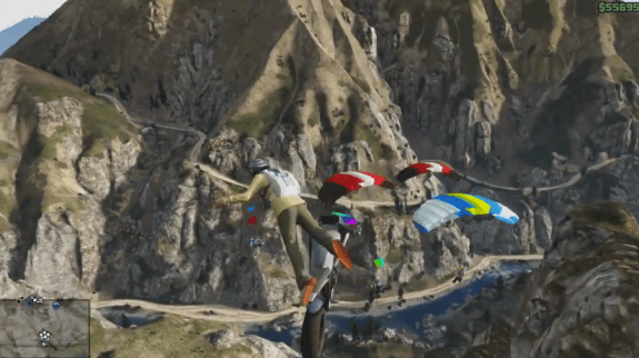 Drive a dirt bike off a cliff and parachute to safety. Why? Just because.