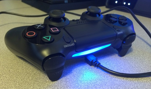 Connect the PS4 DualShock 4 controller with the included cable.