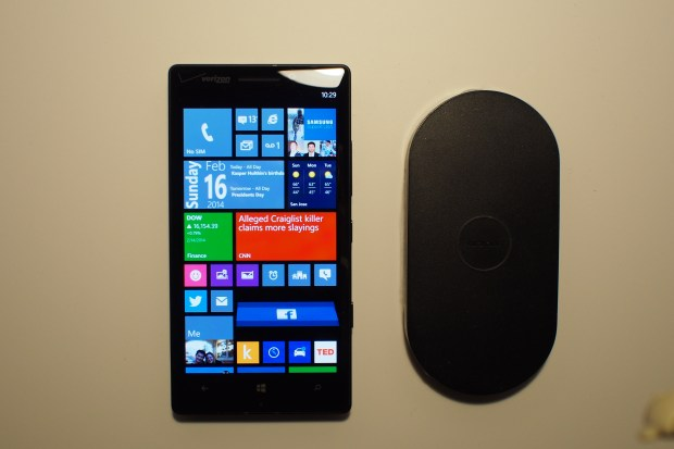 Lumia Icon next to wireless Nokia charging plate.