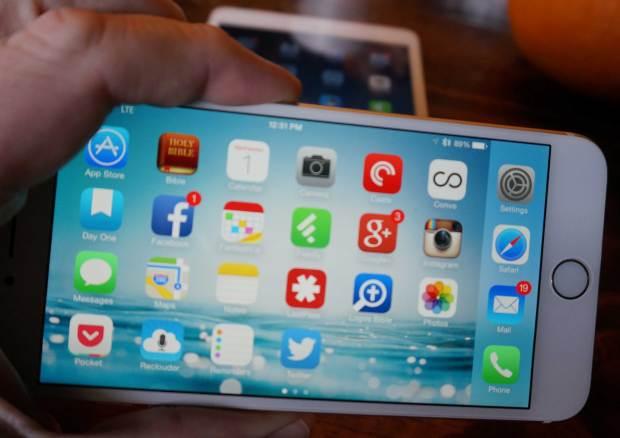 iphone-6-plus-in-hand-above-mini