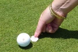 Image of woman marking ball