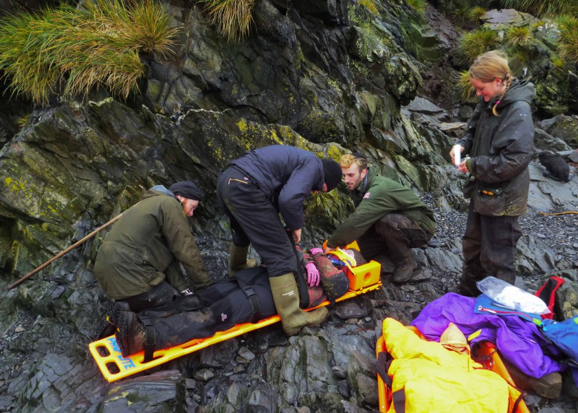 Search and Rescue: making sure the casualty is secure in the spinal board before attaching an oxygen mask and transferring her to the stretcher