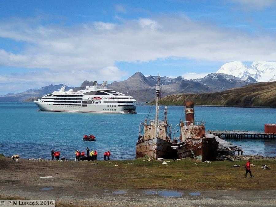 cruise ship Le Soleal next to historic sealers Albatross and Dias