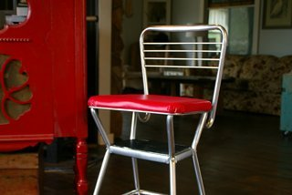 My Grandma's old Costco step stool gets a much needed DIY makeover, before and after using chrome spray paint and red vinyl to recover the seat!