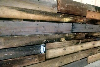 Basement progress with barn wood and pallet wood up on the wall and I took a tumble, adding insult to injury.