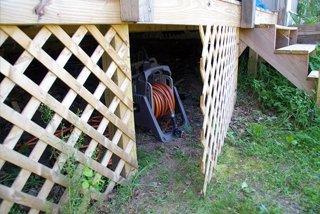 Creating a cubby under our lattice deck diy backyard hidden outdoor outside storage ideas