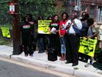 Attorney Johny Barnes with Ivy City residents outside of Crummell School.