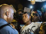 micahel-brown-ferguson-police-and-protestor-1