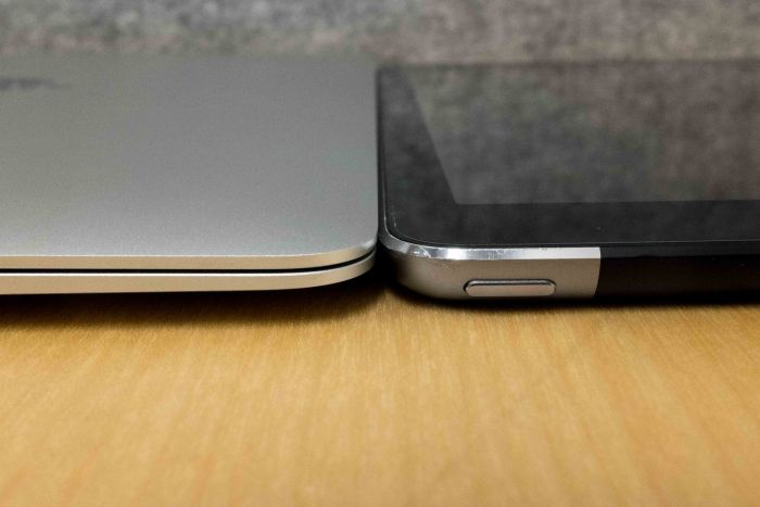 Apple's new MacBook's thickness, compared to an iPad Air