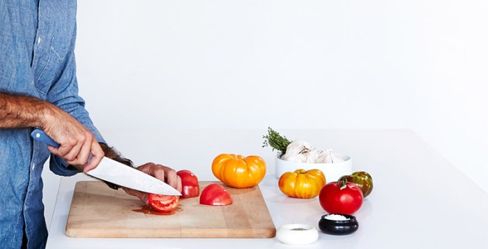 Man cutting tomatoes with Misen chef knife