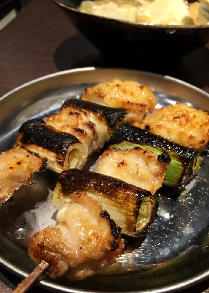 Grilled chicken wing sticks and leeks at Shimonya