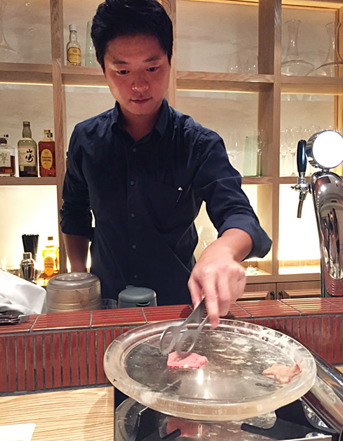 The restaurant cooks the premium wagyu meat over a crystal plate