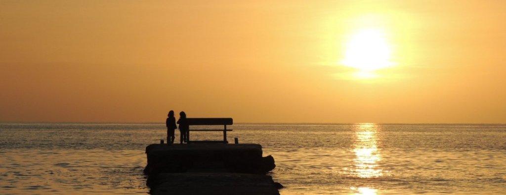 Arillas pier in the sunset