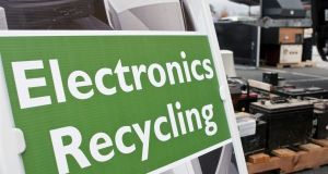 "Lawrenceville, GA, USA - November 23, 2013:  An ""Electronics Recycling"" sign marks the spot for people to drop off old computers, TV's , etc. at Gwinnett County's America Recycles Day event."