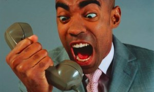 black man yelling into phone 300x180 Yell at Your Phone to Charge It: New Piezoelectric Device Could Help You