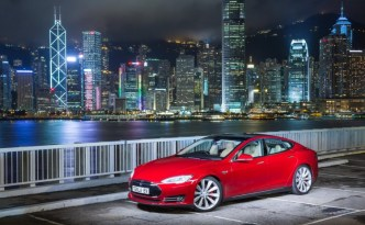 Red Tesla Model S at the Hong Kong Harbour front