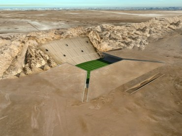 The Rock Stadium Rises from the Desert in Sharp Planes