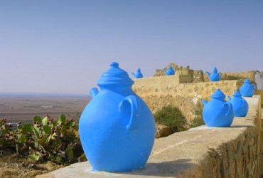 Tunisian Water Distributor Puts People Ahead of Commerce Amid Shortages
