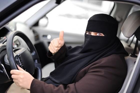 abu dhabi muslim green driver hijab woman