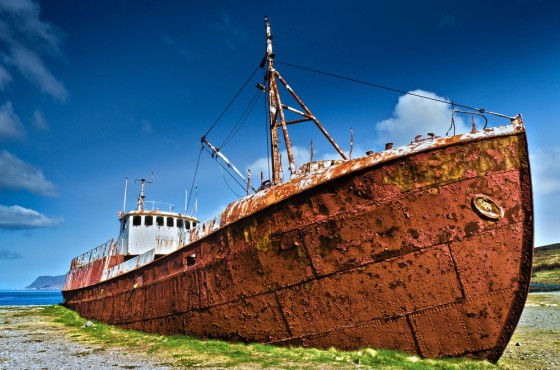rusty hull of a ship for solar power