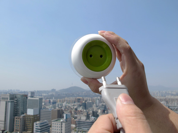 Stick the Solar-Powered Window Socket on Glass and Watch it Charge