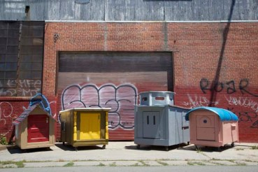 Tiny trash homes create humanity with salvaged waste