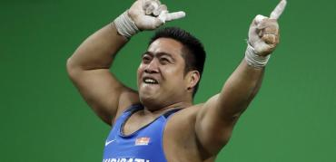 Olympian David Kiribati dances against climate disaster