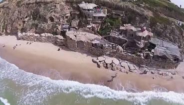 Drone spots amazing hobbit home on Mediterranean shoreline!