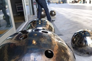"""""""Bowling ball"""" sculptures on the Laurens Street  lobby entrance."""