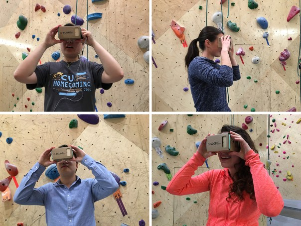 Climbers at Brooklyn Boulders look at SEEGREENNYC