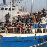LaPresse 21-11-2010 Crotone, Italia Cronaca E' stato fermato dalla Guardia di finanza di Crotone un veliero con a bordo 137 clandestini di origine afgana, irachena e bengalese, tutti uomini. La barca a vela su cui erano trasportati  lunga circa 25 metri, di battente e bandiera russa, ma ancora non  chiaro da dove sia partita. I clandestini sono stati portati al centro di prima accoglienza Sant'Anna. Ancora sono in corso le indagini per capire chi siano gli scafisti, nascosti fra gli altri. Nella foto: i clandestini che ricevono un primo soccorso