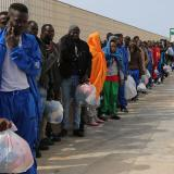 Migrants wait to board on a cruise ship as they leave the Island of Lampedusa, Southern Italy, to be transferred in Porto Empedocle, Sicily, Friday, April 17, 2015.  An unprecedented wave of migrants has headed for the European Union's promised shores over the past week, with 10,000 people making the trip. Hundreds  nobody knows how many  have disappeared into the warming waters of the Mediterranean, including 41 migrants reported dead Thursday after a shipwreck. (ANSA/AP Photo/Francesco Malavolta)