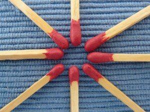 Matchsticks on a fabric background