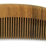 Photo of a wooden beard comb.