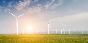 A-group-of-windmills-over-a-green-field-under-the-blue-sky-