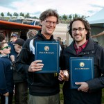 Festival founder Adam Zacks, right, and  Live Nation NW president Jeff Trisler receive the Washington State Governor's Recognition Award