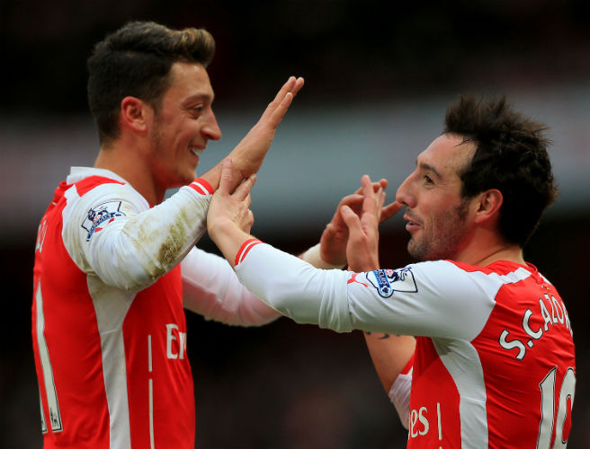 Santi Cazorla and Mesut Ozil spice up this team, while exploiting spaces like spies.