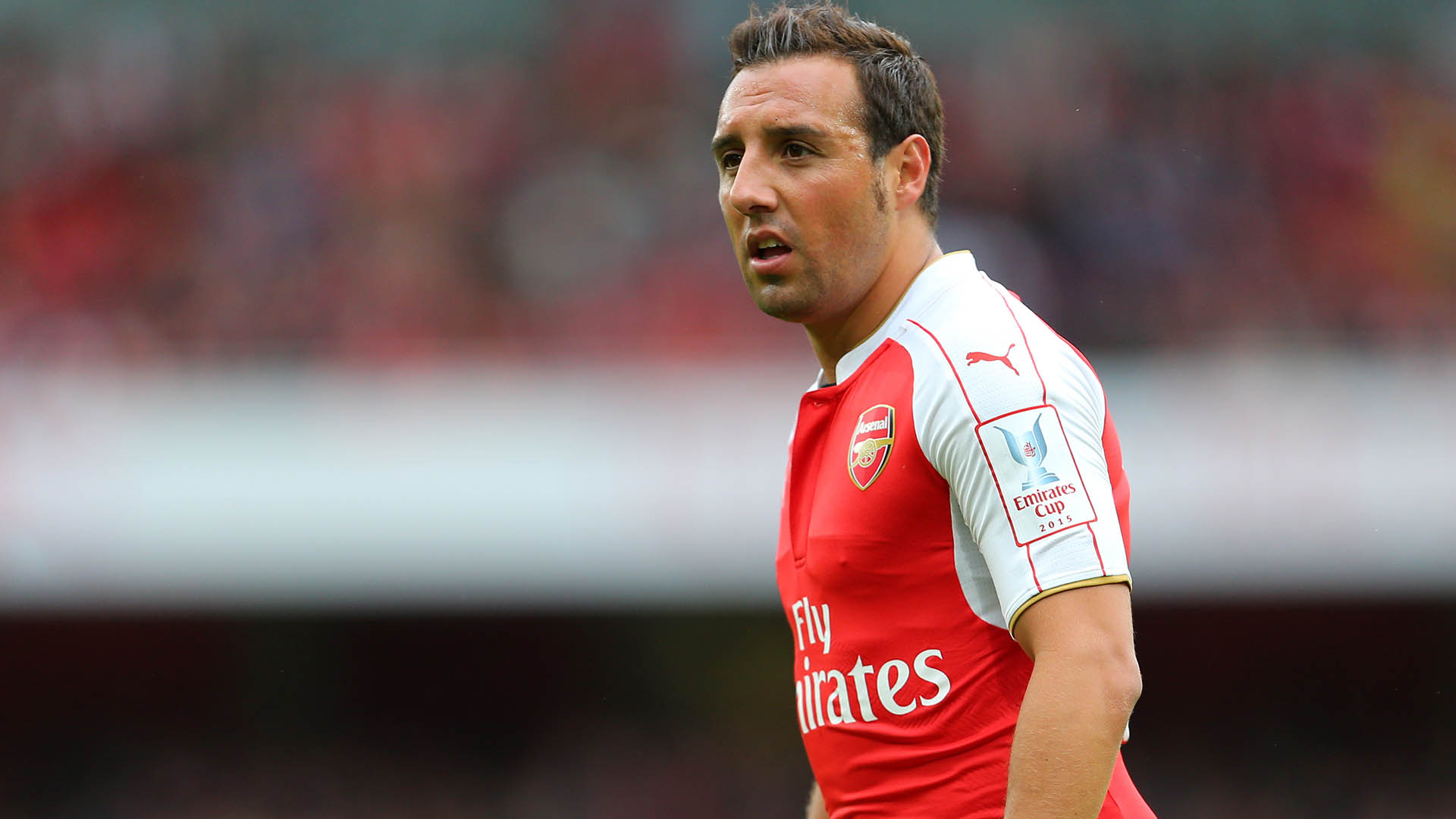 LONDON, ENGLAND - JULY 26: Santi Cazorla of Arsenal during the Emirates Cup match between Arsenal and VfL Wolfsburg at Emirates Stadium on July 26, 2015 in London, England.  (Photo by Catherine Ivill - AMA/Getty Images).