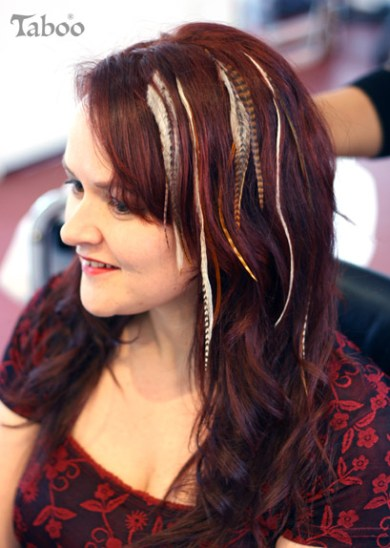 Hair style using feather extensions.