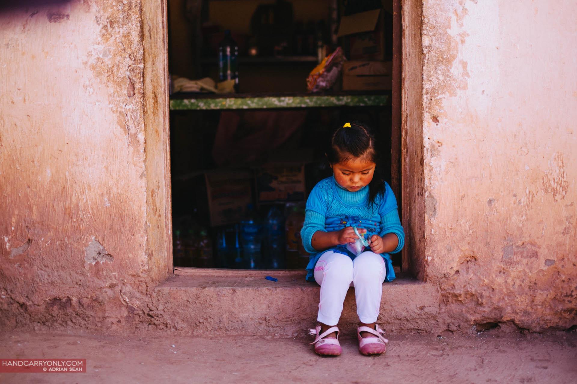 Little girl by the roadside Potosi Bolivia