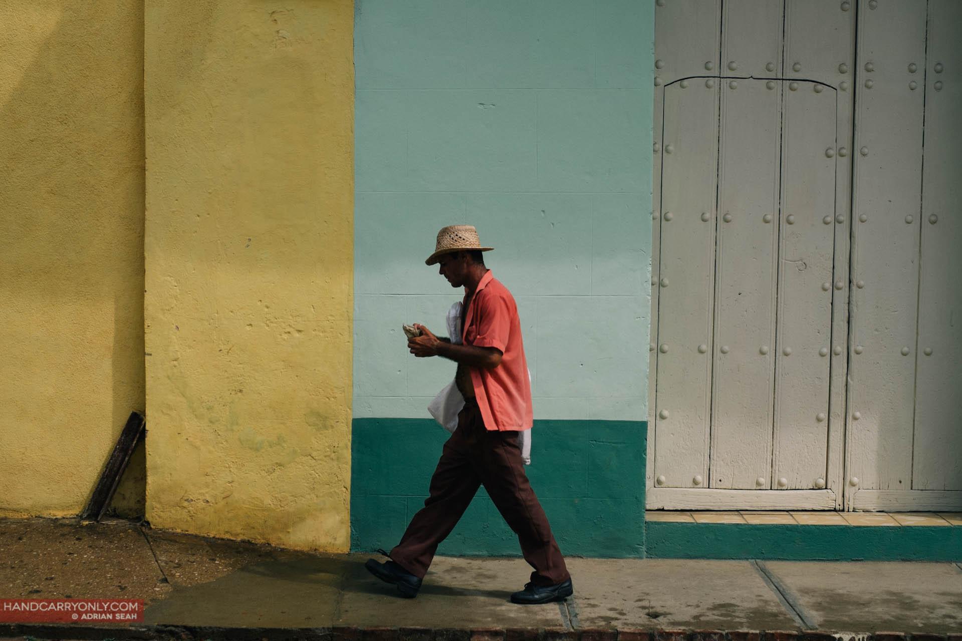 man walking coloured wall trinidad cuba