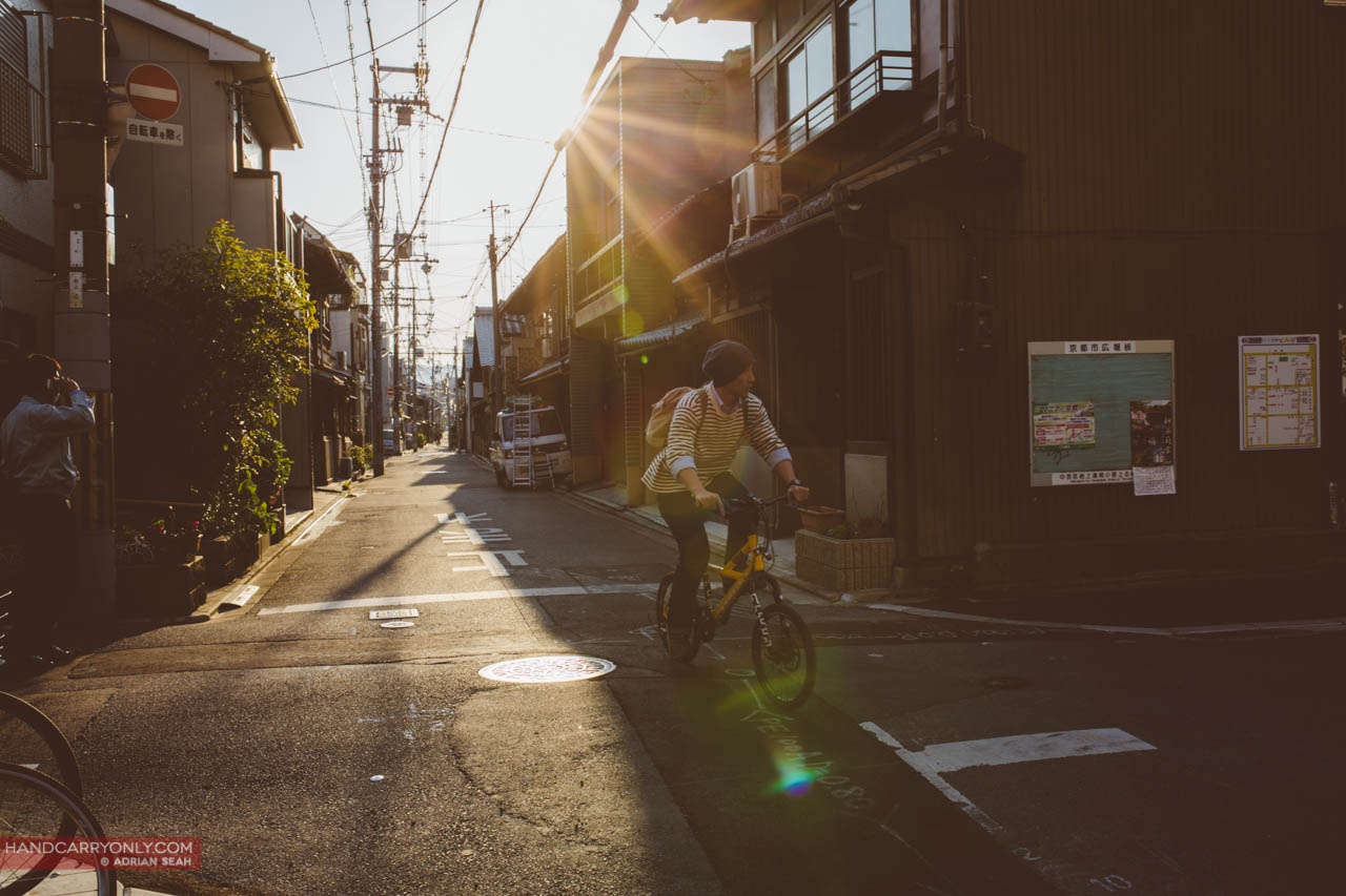 cyclist late afternoon sun kyoto japan