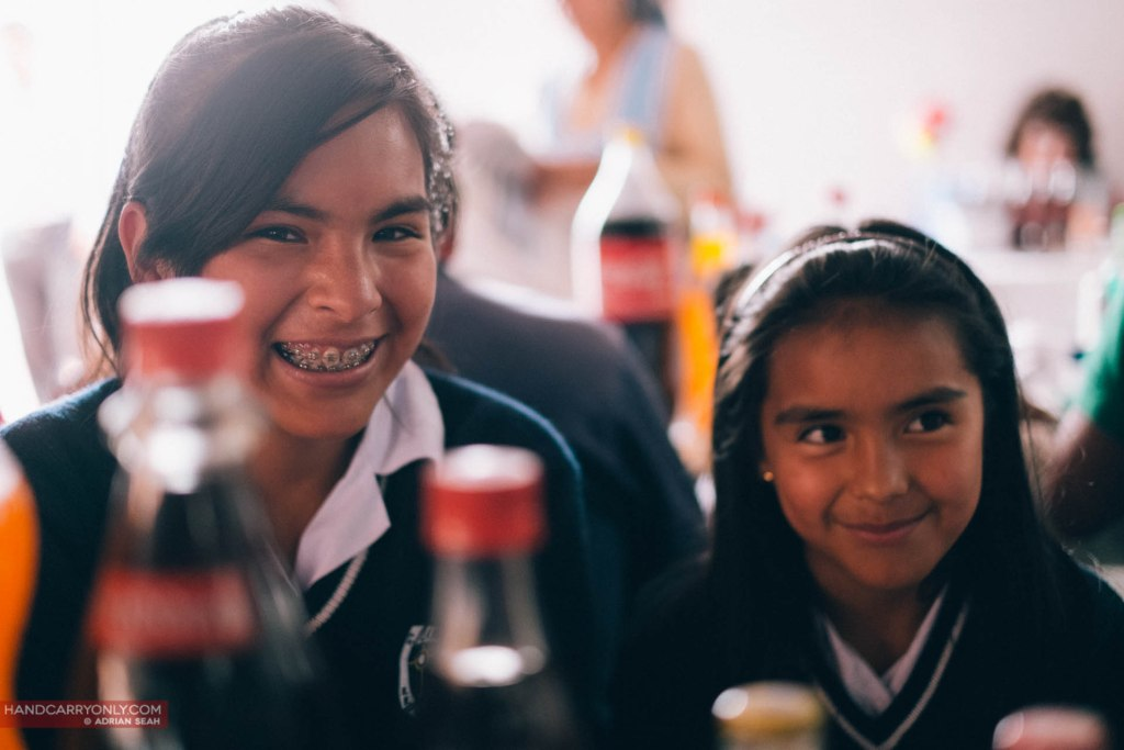 Bolivian school girls at lunch smiling